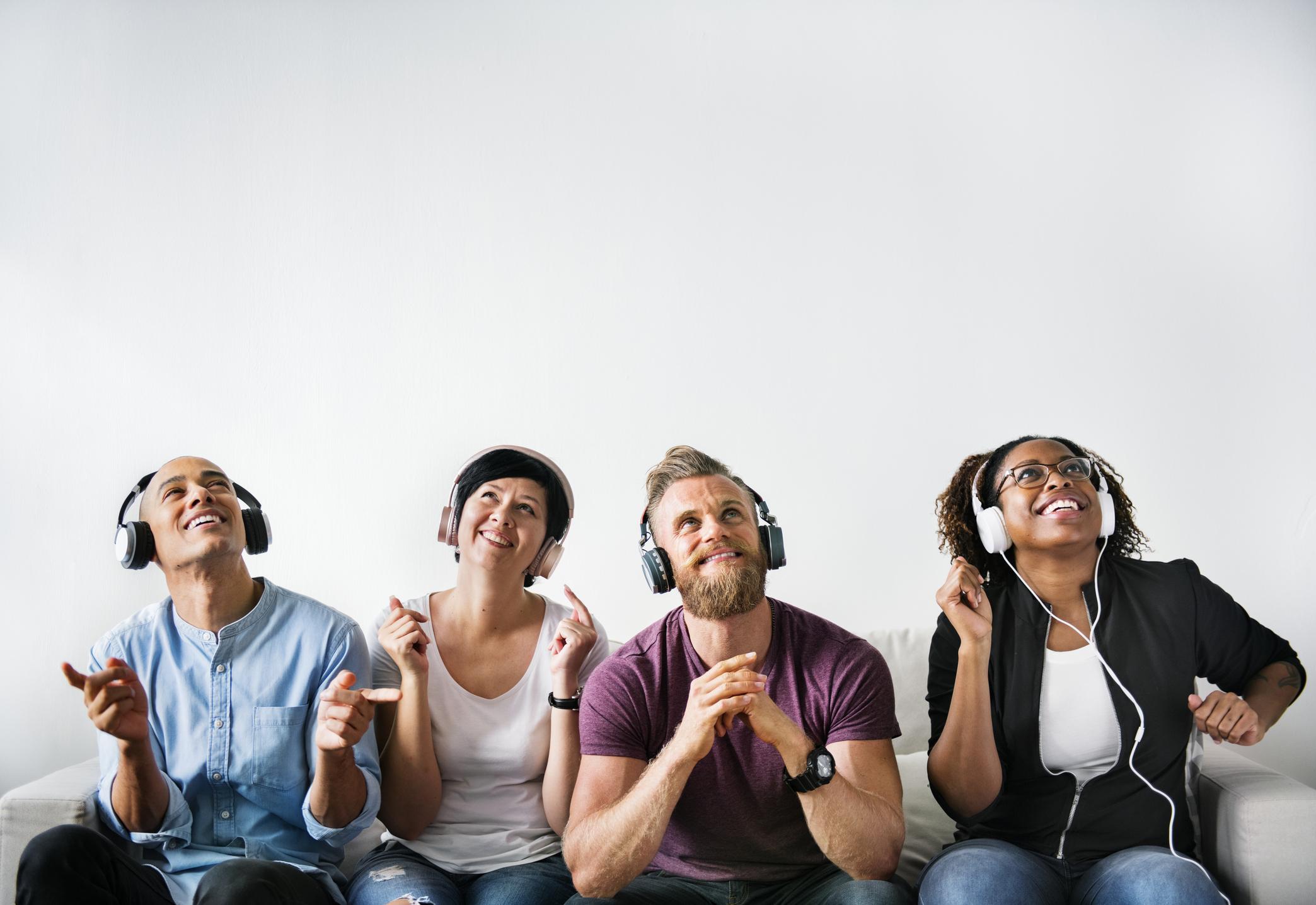 Happy looking people listening with headphones.