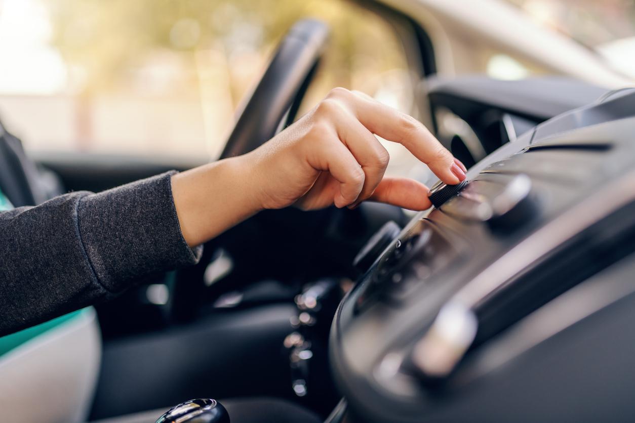person using car radio