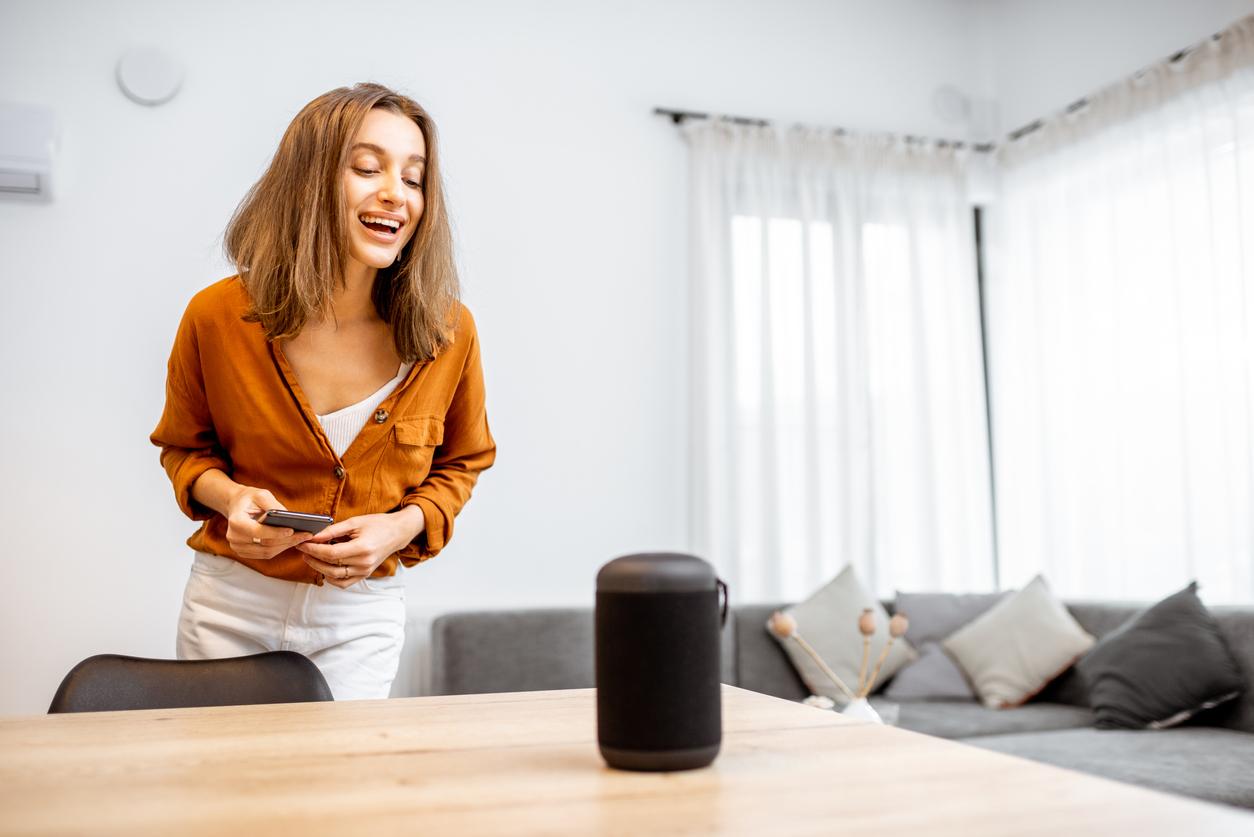 woman using smart speaker