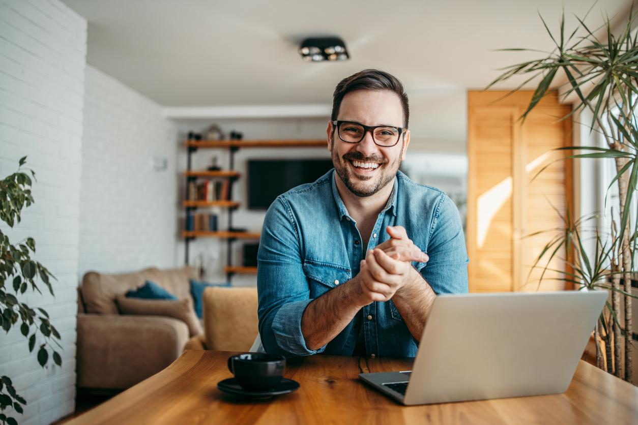 man at computer smiling