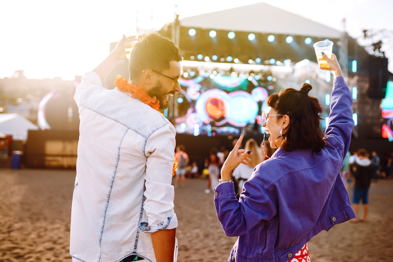 Two people looking at each other at a concert
