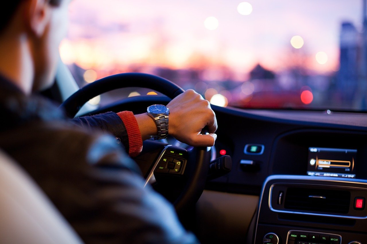 Man With Watch On Wrist Drives A Car