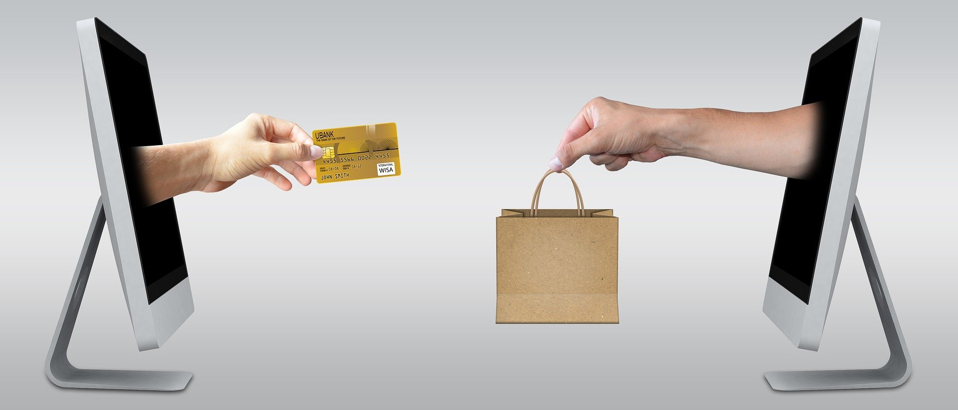 Within computer monitors, a transaction occurs with a credit card from one screen to a bag on another.