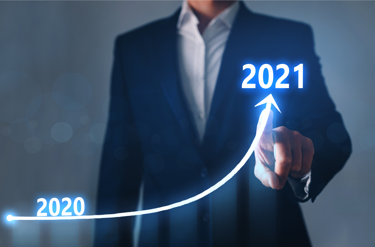 Businessman pointing arrow graph corporate future growth year 2020 to 2021.